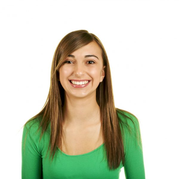 Portrait of a beautiful brunette teenage girl with a nice smile