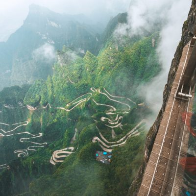 people on glass walk at Tianmen mountain in zhangjiajie